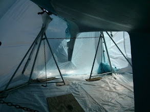 Photo: Looking aft along starboard inside tent prior to removing bottom paint.