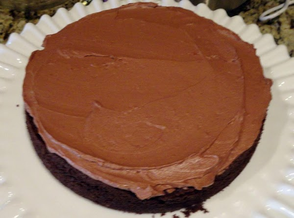 CAKE ASSEMBLY: Remove frozen layers from freezer and put on a platter lined with...