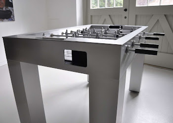 side view of the Kicker Foosball Table in a garage
