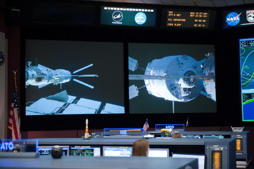 ISS Orbit 2 flight controllers on console with Flight Director Bob Dempsey
