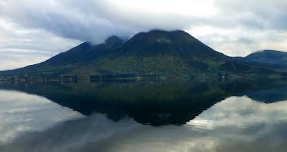 Photo: Shrouded Imbambura reflected in lake