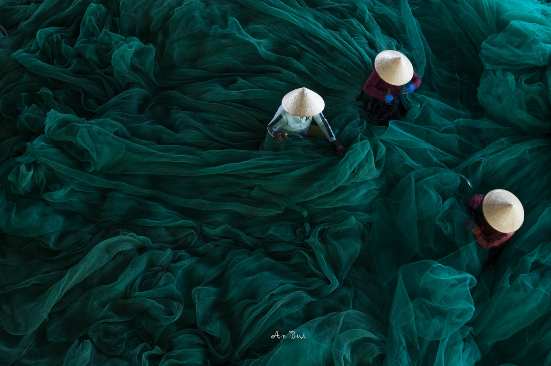 Blue net mending in Nha Trang
