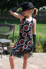 Photo: To buy (CSD018- We're in the money) email me at Pam@Act2DanceCostumes.com  $35.00 Qty (1)  Size: (1)Med Child.  Slip on dress w/red sequin money signs cirlcled by silver sequin.  Dress is trimmed with black fringe w/silver sequin scattered throughout.  Comes with gloves and hat.  Wear with your own black spankies or booty shorts.  Great for Jazz or Tap!! Paypal/Checks accepted.  $7US shipping/$2 additional items  7 Day returns, same condition.  Thanks!