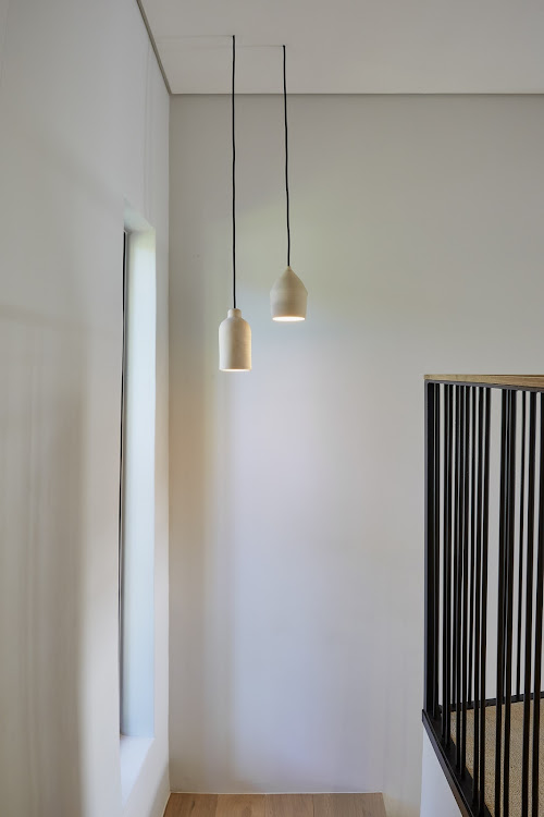 Note how the cords of these pendant lights have been skimmed into the ceiling.