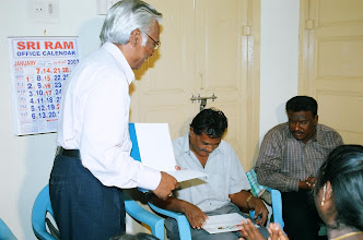 Photo: The Chief Guest Mr.Sudarshan takes a look at the certificate of award