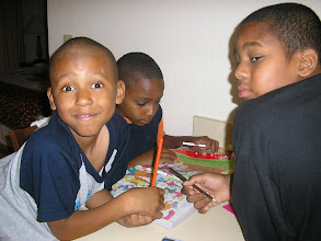 Photo: Izjan smiles at the camera, while Kamau looks suspiciously at it. Miles ignores me.