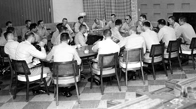 Photo: General McC Tate and Capt Duffy exchange information over coffee, on June 5, 1959, with Flight Instructors and Students