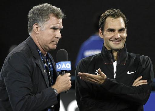 In high spirits: Roger Federer, right, sees the funny side while being interviewed by comedian Will Ferrell. Picture: REUTERS