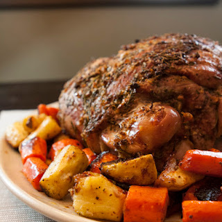 Roasted Leg of Lamb Recipe with Mint Sauce and Root Vegetables.