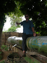 Photo: Mick on a Russian missile left behind on the Ho Chi Min Trail.