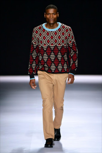 A model wearing a Maxhosa by Laduma Ngxokolo design.