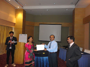 Photo: Participant receiving certificate from Dr.Manjunath