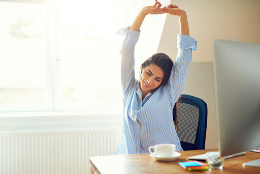If You Work At A Desk All Day, Here Are 4 Stretches To Combat Lower Back Pain