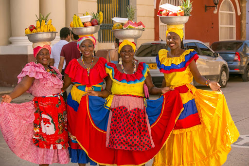 cartagena-tradition.jpg - Women pose in traditional dress in Old Cartagena, Colombia.
