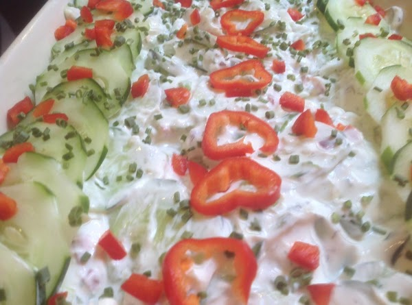 Add mixture to large 9X12 X2 inch Casserole dish. Then top with additional cucumbers,...
