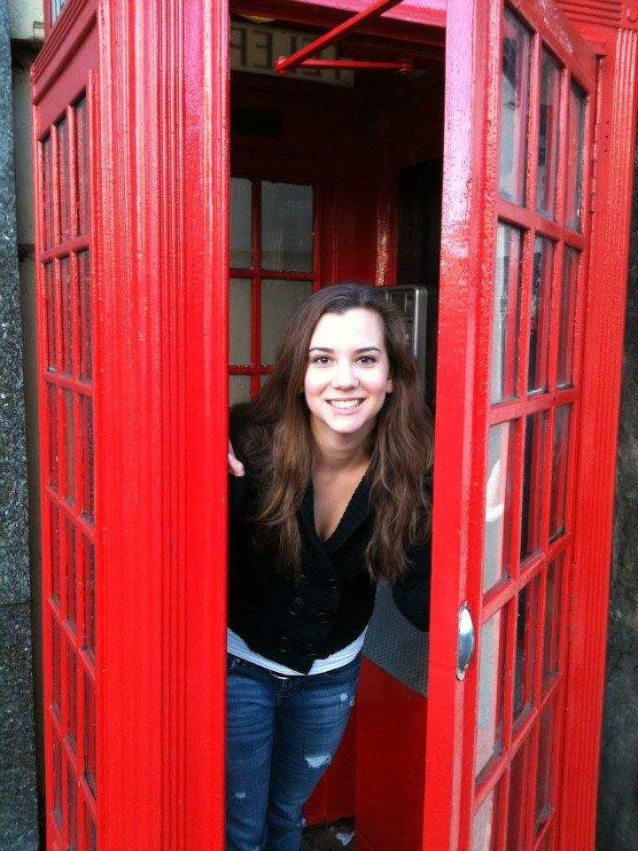 A picture containing telephone booth, outdoor object, red, outdoor  Description automatically generated