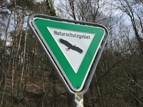"Photo: Later, I would realize why all their ""Nature Reserve"" signs have a bird of prey on them."