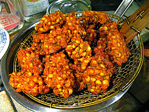 Photo: crisp-fried corn fritters cooling on rack