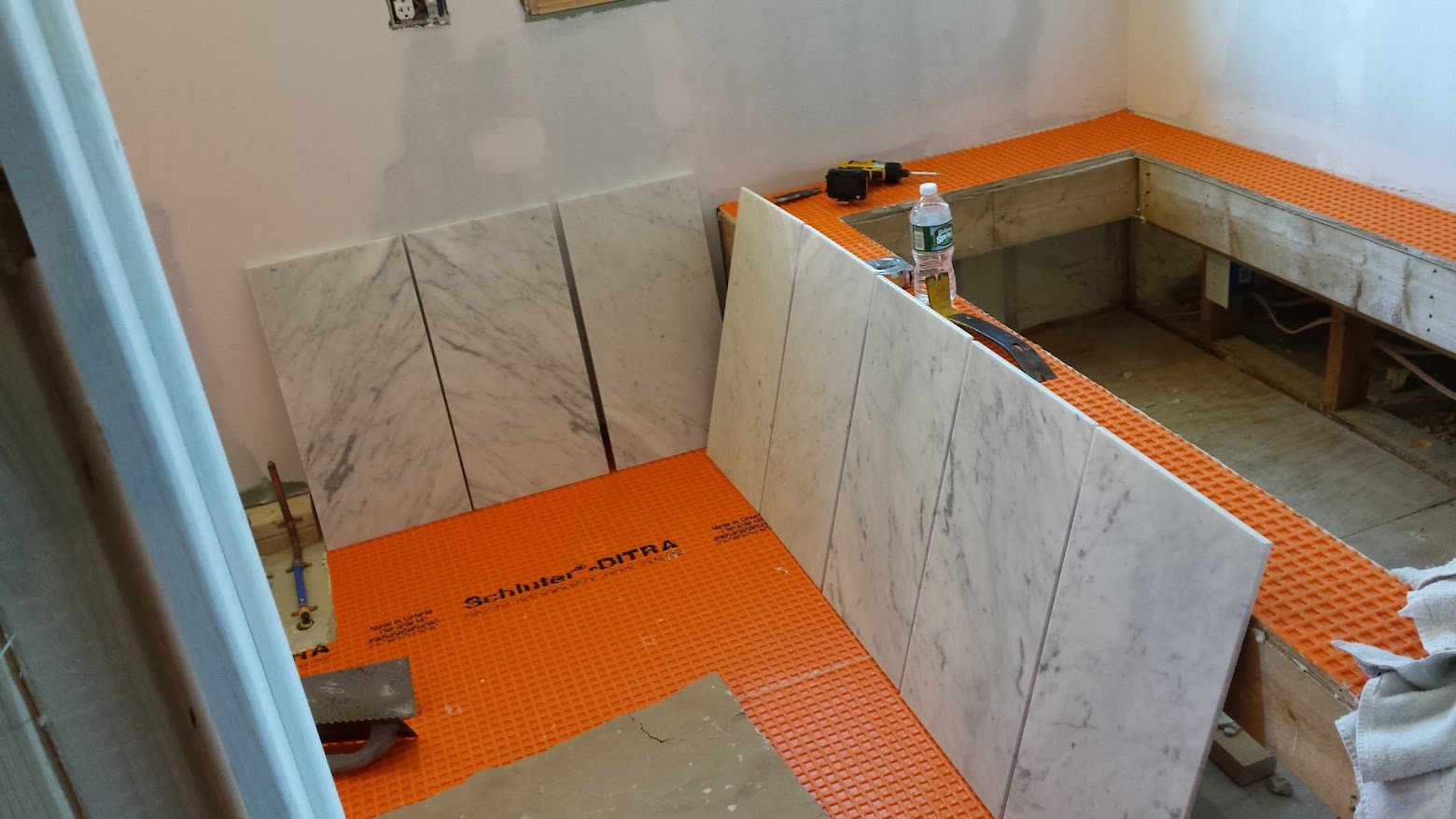 Getting shower tiles ready to go - Schluter Ditra on the floors