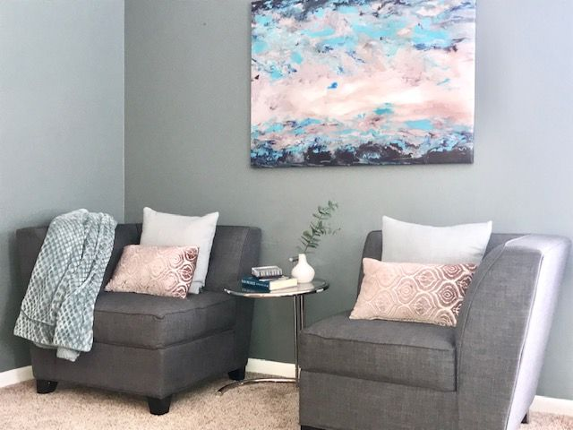 expert styling accessories pink pillows gray sofa end table staged home north chicago abrams solutions