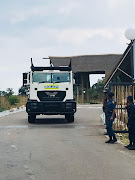 An armoured police vehicle takes up position at  the Ranch Resort in Limpopo, where the South Africans being repatriated from Wuhan, China, will be quarantined.