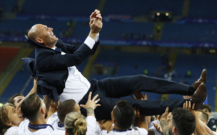 Zinedine Zidane gets the treatment from his victorious Real Madrid players after they beat Atletico Madrid in the Uefa Champions League final. Picture: REUTERS/KAI PFAFFENBACH