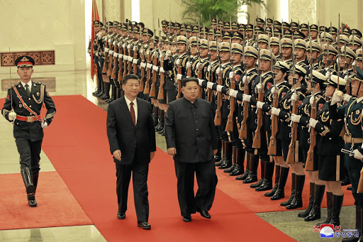 North Korean leader Kim Jong-un and Chinese President Xi Jinping inspect honour guards, during Kim's unofficial visit to Beijing, in this undated photo released by North Korea's Korean Central News Agency (KCNA) on March 28 2018. Picture: KCNA VIA REUTERS