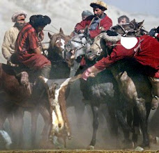 """Photo: Afghans play buzkashi in Kabul November 1, 2002. Buzkashi, or """"goat dragging"""", is played with two teams of horsemen competing to throw a beheaded 30-kilo calf, goat or sheep, as the ball, into a scoring circle. The Afghan national sport, outlawed during the Taliban regime, originated centuries ago in Central Asia and is held throughout the northern parts, especially in Kunduz and Mazar-I-Sharif, from late October to March every year. Before the Soviet occupation in 1979, the buzkashi winning teams came to Kabul to play in front of King Zahir Shah in honour of his birthday.    REUTERS/Bazuki Muhammad"""