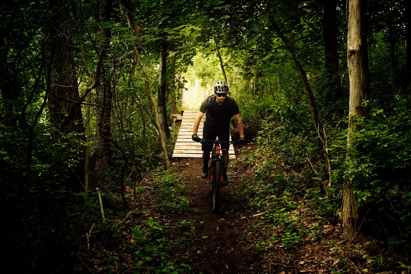 biker riding skyrunning girl naia tower-pierce djswagzilla woods trails running runners ways to stay safer on the trails DITCH THE HEADPHONES. 8 Ways to Stay Safer While Running
