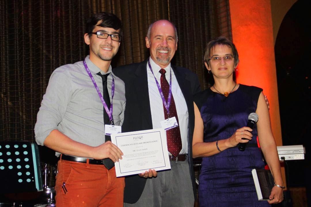 Photo: Evan with Prof. Larry Scott and Prof. Marina Petrukhina