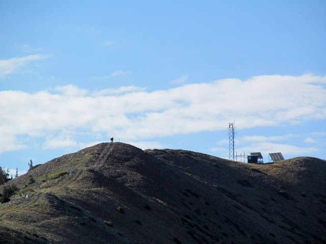 Hiker and radio tower