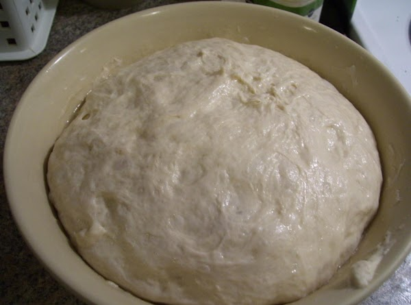 Do a third stretch-and-fold, oil the bowl and return the dough to it, cover...