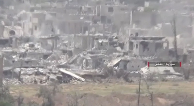 A still image taken from a video uploaded by the Syrian Army on May 13 shows damaged buildings  on the edge of the capital, Damascus. Picture: REUTERS