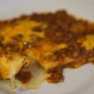 Cheese Enchilladas with Chili Con Carne Meat Sauce.