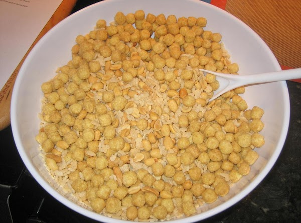 Melt white chocolate chips & pour over cereal mixture; mix well.