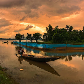 The Evening Boatman by Manabendra Dey - Landscapes Sunsets & Sunrises ( clouds, boatman, evening colours, sunset, sonbeel, boat )