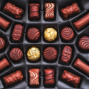Chocolate candies in the box by Roberto Sorin - Food & Drink Candy & Dessert ( gift, romance, assortment, gourmet, truffle, red, white, cake, nobody, day, decoration, assorted, cookie, shape, milk, cream, brown, delicious, cocoa, heart, celebration, traditional, closeup, background, tasty, present, sugar, chocolate, birthday, love, pink, color, confection, candy, snack, isolated, yellow, box, confectionery, holiday, romantic, dark, praline, eat, chocolates, valentine, food, pastry, dessert, sweet,  )