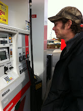 Photo: Hubby pumping gas