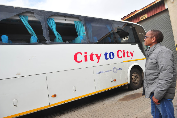 Prasa spokesperson Makhosini Mgitywa next to one of two City to City buses which were shot at near Sosolburg by unknwn people enroute to the Eastern Capo in a space of six days.