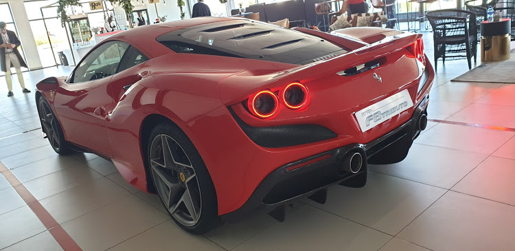 Quartet of tail lights revive styling of Ferrari icons like the 308 and F40.