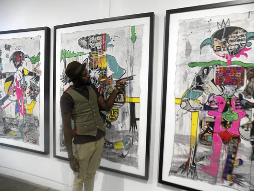 Critical:  Surreal artist Blessing Ngobeni's paintings feature bold colours and thick layers of paint. Picture: SUPPLIED