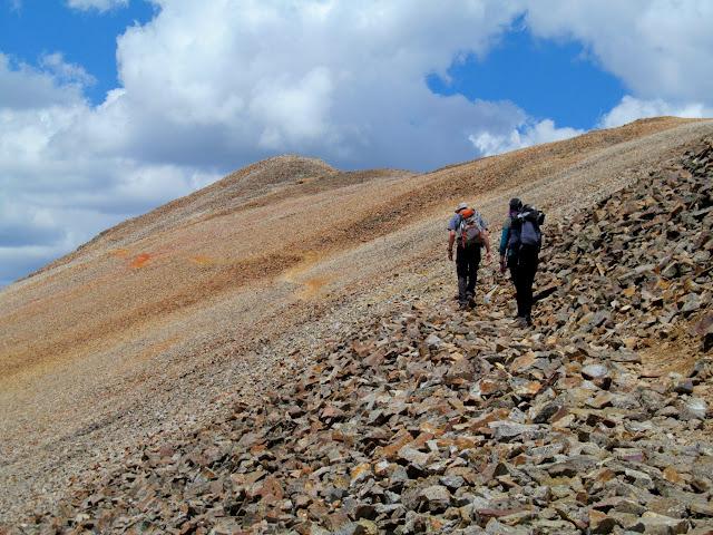 Ascending Redcloud Peak with a false summit ahead