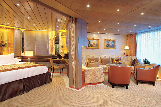 ms-amsterdam-pinnacle-suite - A Pinnacle Suite with Veranda on Holland America's ms Amsterdam has floor to ceiling windows and a guest bathroom.