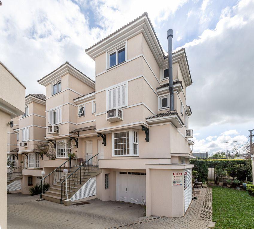 Casa com 3 dormitórios para alugar, 212 m² por R$ 4.800,00/mês - Chácara das Pedras - Porto Alegre/RS
