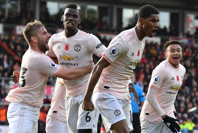 Manchester United's English striker Marcus Rashford (2R) celebrates scoring his team's second goal during the English Premier League football match between Bournemouth and Manchester United at the Vitality Stadium in Bournemouth, southern England on November 3, 2018.
