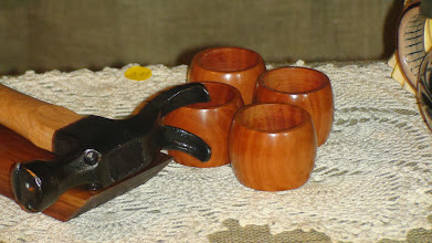 Photo: Turned cherry napkin rings -- donated to General Store for Sale -- along side one of the Blacksmith's custom-made and decorated hammers