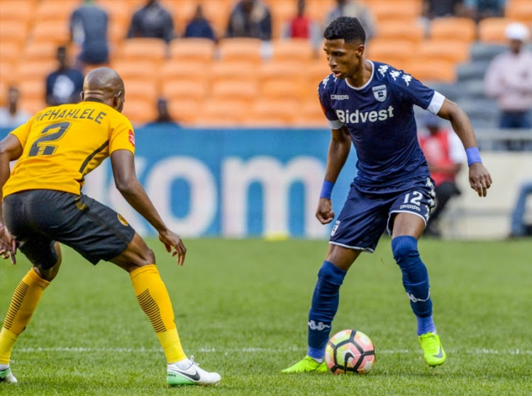 Vincent Pule of Wits and Ramahlwe Mphahlele of Kaizer Chiefs during the Absa Premiership match between Kaizer Chiefs and Bidvest Wits at FNB Stadium on May 26, 2017 in Johannesburg.