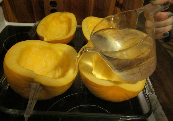 Place your two pumpkin halves, cut side up on a baking pan. Then add...
