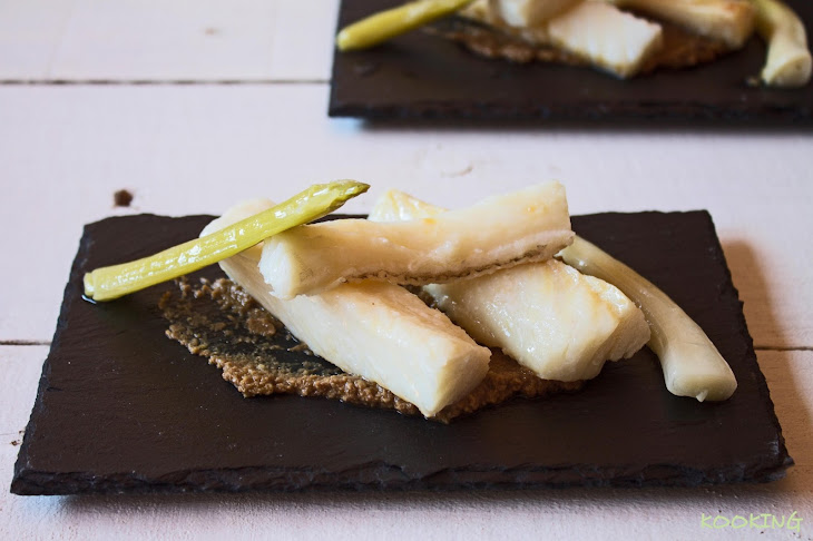 Cod and Preserved Green Onions Over Green Olives Tapenade