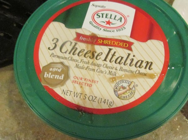 Add the 3 cheese Italian cheese blend or parmesan, then cover with a lid...